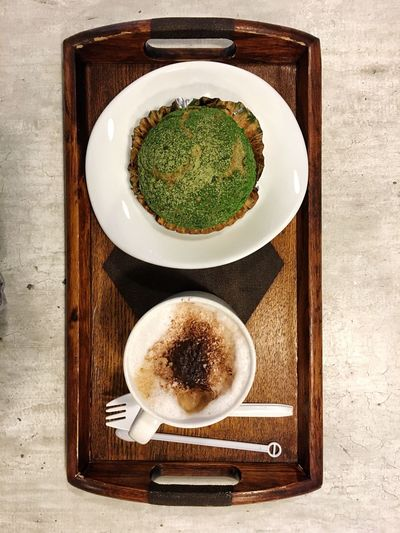Top view of coffee with breakfast on wooden tray