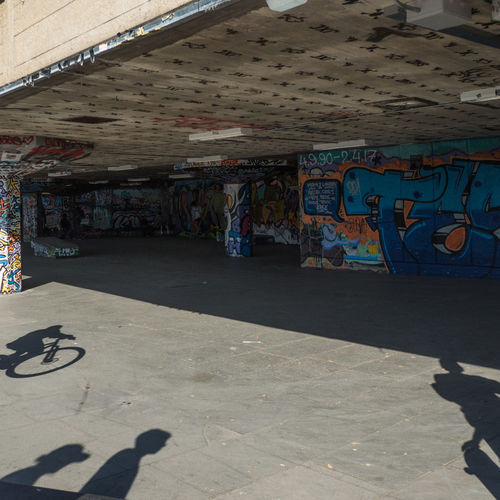 At the Centre of the Action Skater Park South Bank, London Urban Lifestyle Architectural Column Architecture Art And Craft Built Structure Ceiling City Creativity Day Graffiti Multi Colored Outdoors Shadow Skaters South Bank Street Street Art Sunlight Text Urban Wall Wall - Building Feature Wheelie The Street Photographer - 2018 EyeEm Awards