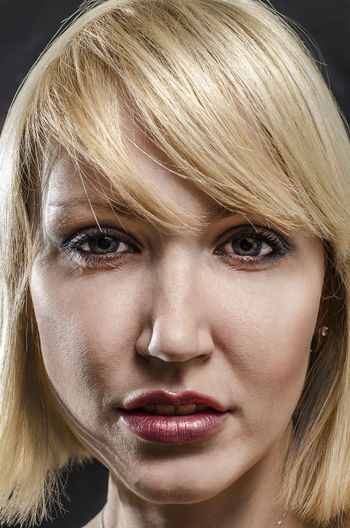 Blond Hair Portrait Hair Young Adult Close-up One Person Hairstyle Headshot Adult Make-up Young Women Women Indoors  Beauty Emotion Beautiful Woman Human Face Black Background Bangs Intense Looking At Camera Big Lips Lipstick Caucasian European Girl