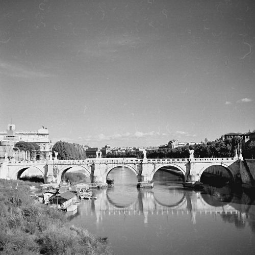 Arch bridge over tiber river against sky