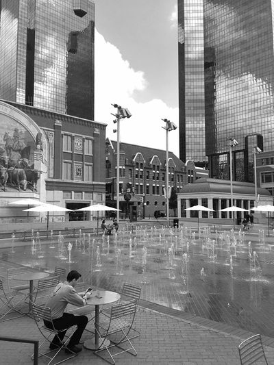 Building Exterior Architecture Real People Sitting Built Structure City Day Women Outdoors People Men One Person Adult Sky Adults Only Sundance Square Ft Worth Texas Urban Landscape Street Photography Monochrome Photography
