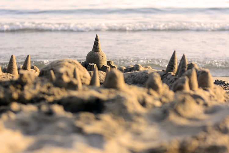 Sandcastle with the sea in the background.