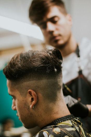 Hairdresser trimming stylish cut