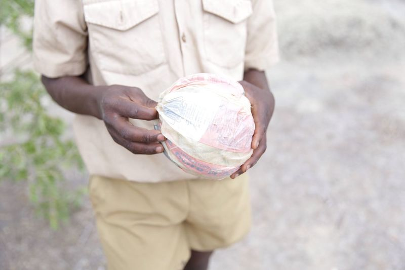 Football Fever The Photojournalist - 2016 EyeEm Awards A student from Domboshawa Primary School in Zimbabwe shows me his soccer ball made of plastic packets.