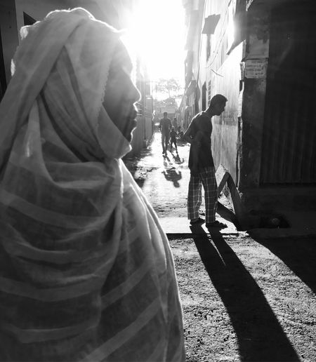 Two People Sunlight People Men Outdoors Black And White City Street Walking Road The Great Outdoors - 2017 EyeEm Awards The Street Photographer - 2017 EyeEm Awards Photographer Jashimsalam City Sunlight Women Street City Life Winter Blac&white