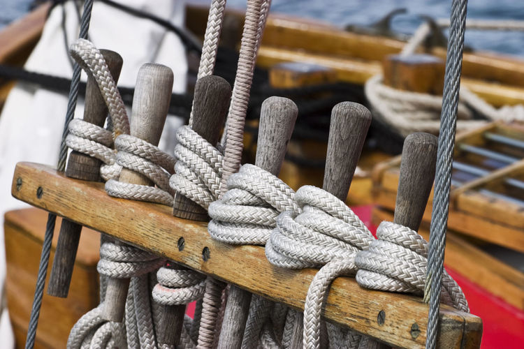High angle view of ropes tied on wood