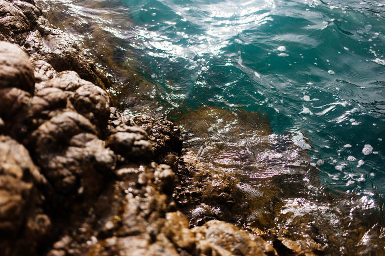 Blue sea water textured background Copy Space Beauty In Nature Close-up Day High Angle View Nature No People Outdoors Rock - Object Sea Selective Focus Sunlight Textured  Water