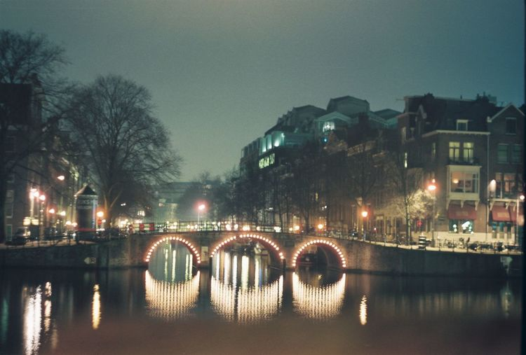 Archive pics from Eurotrip in 2013. #filmisnotdead Amsterrdam Architecture Bridge - Man Made Structure Building Exterior Built Structure Channel City City City Life City Street Cityscape Cityscapes Connection Illuminated Night Night Lights Nightphotography No People Outdoors River Riverscape Sky Transportation Tree Water