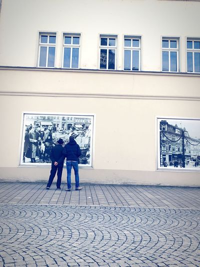 Two persons looking at old pictures Real People Architecture Building Exterior Lifestyles Street View Built Structure Full Length Men Day Rear View Two People Outdoors Togetherness Outside Architecture Facade Architecture_collection Old But Awesome Architecture Old Picture Time Time To Reflect Old Times Pictures Tell A Story Black And White Pictures Looking The Street Photographer The Street Photographer - 2017 EyeEm Awards