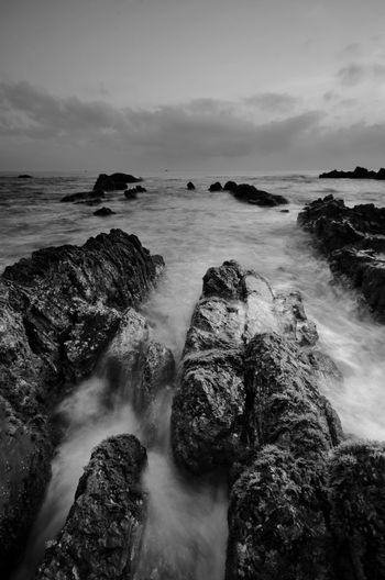 Amazing rock formations at Pandak beach, Terengganu in black and white monochrome fine art technique.  Nature composition blur soft focus noise visible due to long exposure effect. Fine Art Black And White Landscape Amazing View Amazing Fine Art Photography Black&white Black Backgrounds Art Blackandwhite EyeEm Wallpaper Malaysia Water Wave Sea Beach Sunset Beauty Long Exposure Rock - Object Sky Horizon Over Water Seascape Flowing Water Stream - Flowing Water Flowing