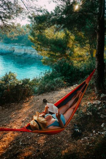 Woman lying down on shore