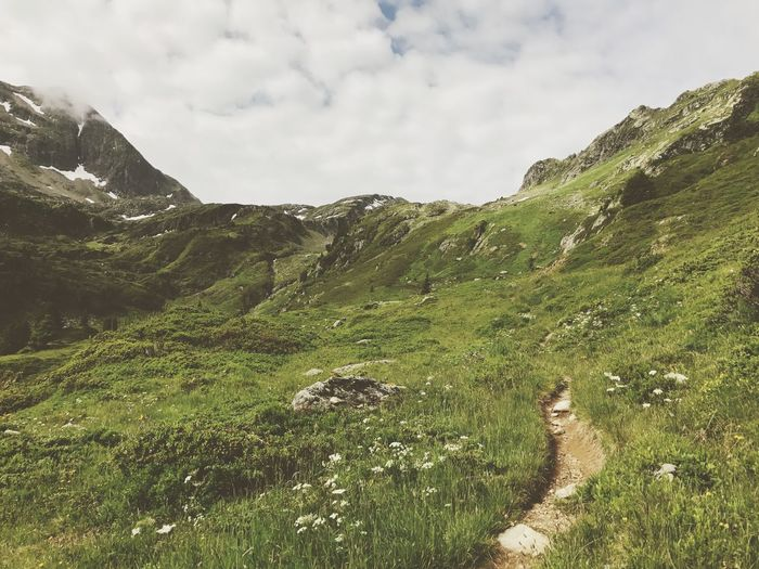 Path Hiking Trail Rock - Object Alps Nature Sky Grass Day Beauty In Nature Mountain Landscape Outdoors No People Scenery