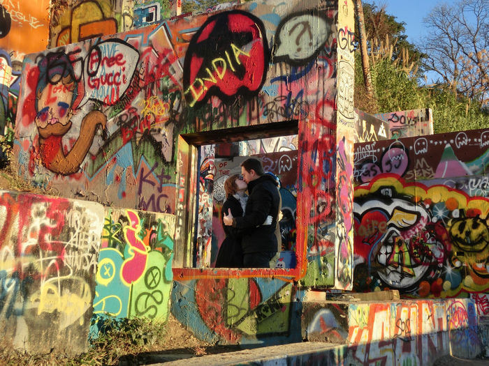 Adult Adults Only Architecture Building Exterior Built Structure City Communication Day Full Length Graffiti Lifestyles Mature Adult Multi Colored One Person Outdoors People Real People Standing Street Art