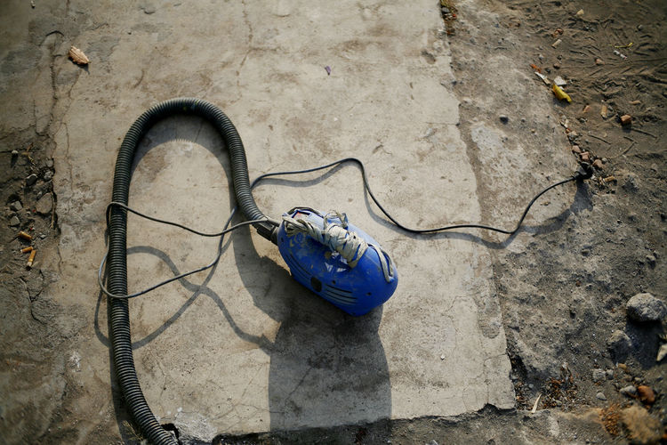 High Angle View Cable Day Nature Blue Outdoors No People Electricity  Connection Land Ground Dirt Equipment Close-up Flooring Tools