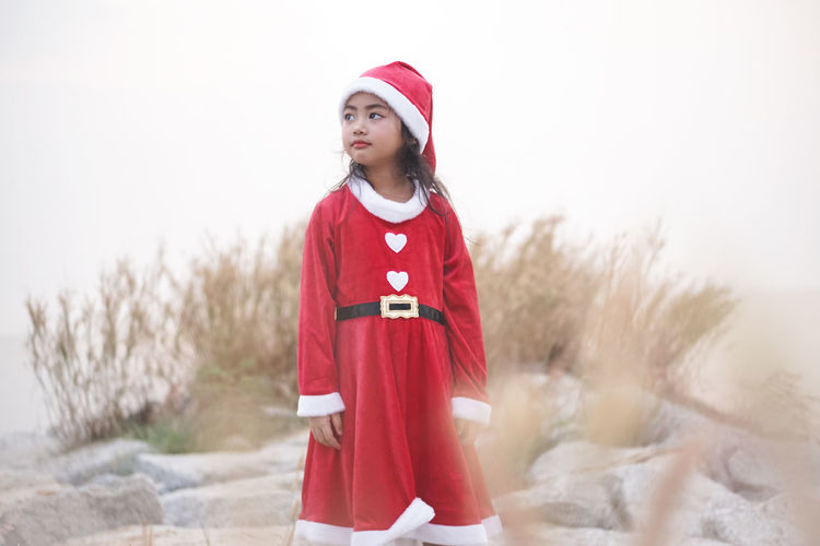 Little girl in Santa dress... at Sea side. Santy  Santa Santa Claus Stone Rock - Object Sea Sea Side Seascape Holiday Girl Little Girl Kid Dress Thailand Asian  Sattahip Chonburi ,Thailand Grass Red Hat Reindeer Smile Happiness One Person Child Winter Standing Offspring Childhood Clothing Three Quarter Length Nature Girls Front View Celebration Christmas Women Cold Temperature Warm Clothing Innocence Cape