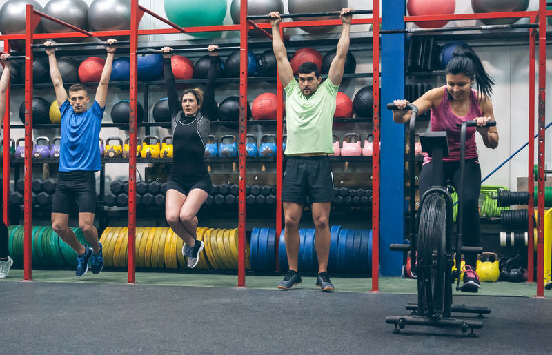 Athletes exercising in gym
