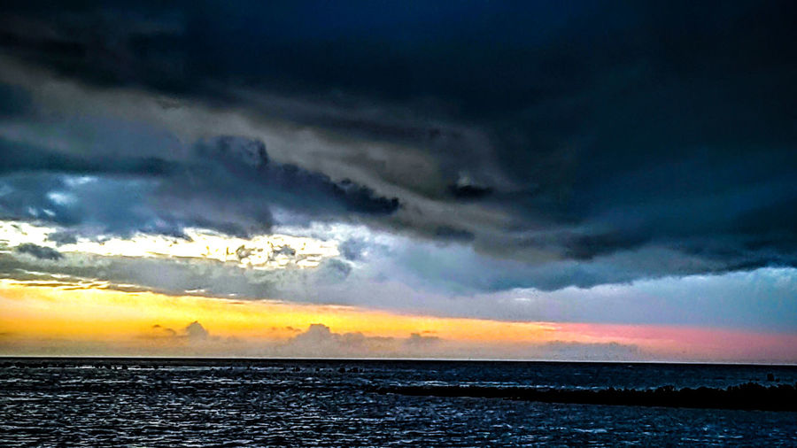 Most colour in the storm h sky 'I've' ever seen. Sea Horizon Over Water Water Scenics Tranquil Scene Sunset Tranquility Waterfront Seascape Dramatic Sky Beauty In Nature Sky Idyllic Rippled Vacations Moody Sky Majestic Nature Cloudscape Atmosphere Stormy Skies Non-urban Scene Cloudy Dramatic Sky Eyeem Market