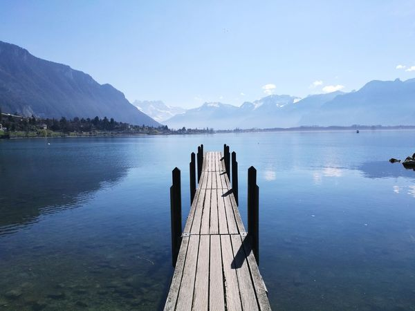 Lake Reflection Mountain Water Nature Landscape No People Outdoors Arrival Beauty In Nature Day Switzerland Geneva Lake Sunshine ☀ Fragility Freshness Nature Silence Of Nature Spring Travelphotography HuaweiP9 Huaweiphotography