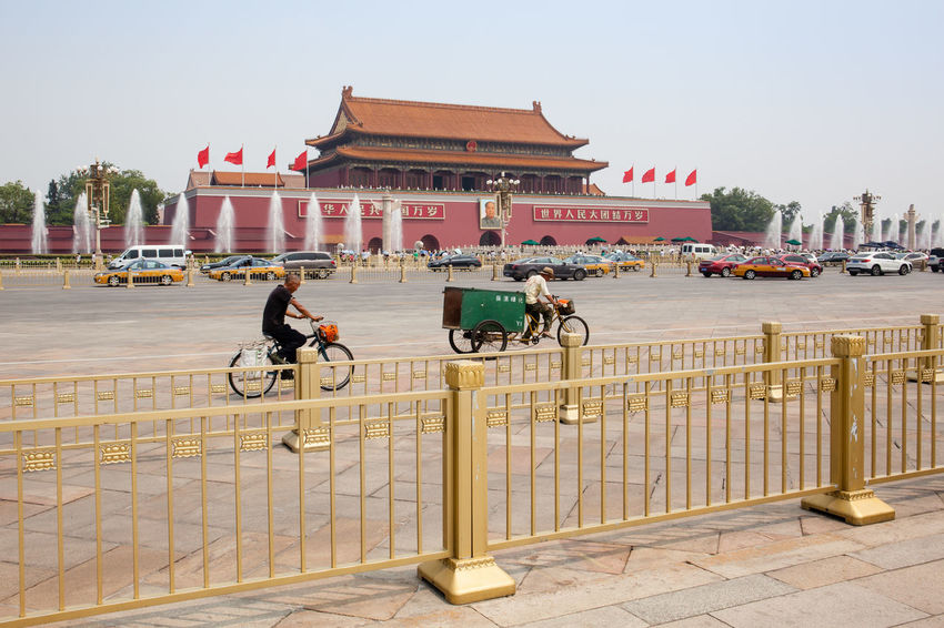 Beijing, China - Jun 20, 2016 : Scene of the Tiananmen square with cars, bicycles and the iconic golden colored fences. Architecture ASIA Beijing Beijing, China China Day Haze Mainlandchina Outdoors Smog Square Summer Tiananmen  Tiananmen Square Tourism Travel Travel Destinations