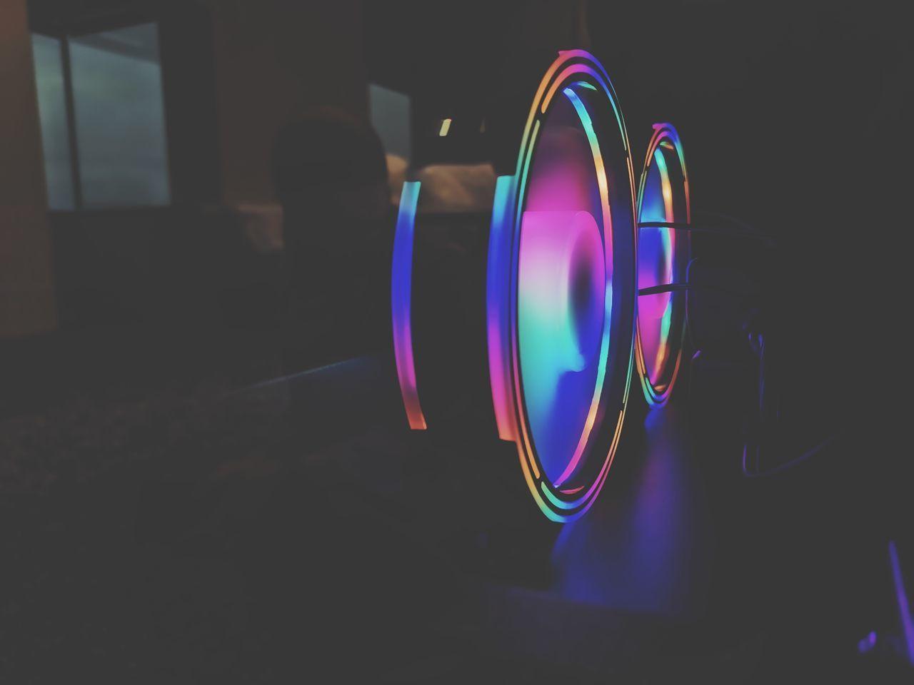 CLOSE-UP OF ILLUMINATED LIGHTING EQUIPMENT IN DARK