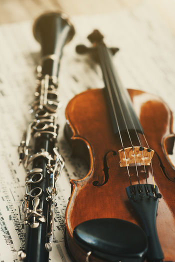 Violin and Clarinet Arts Culture And Entertainment Black Clarinet Classical Music Close-up Indoors  Metal Music Musical Instrument Musical Instrument String No People Notes String String Instrument Wood - Material Woodwind Instrument