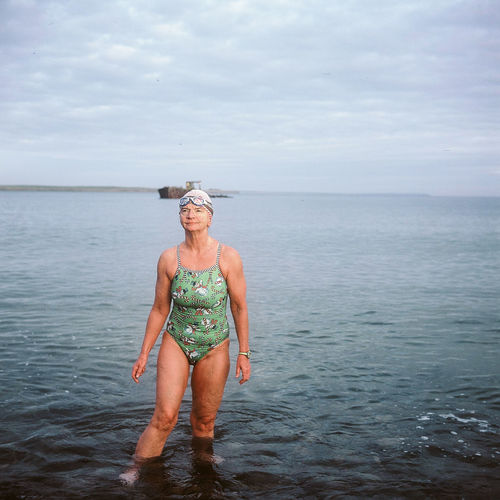 Nicki of The Polar Bears. Cold Water Swimming group in Orkney. From the series Greenvoe. Adults Only Beauty In Nature Day Full Length Happiness Horizon Over Water Leisure Activity Lifestyles Looking At Camera Nature One Person Outdoors Portrait Real People Scenics Sea Sea Swimming Sky Standing Swimming Swimming Pool The Portraitist - 2017 EyeEm Awards Water