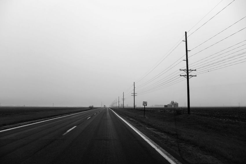 Visual Journal May, 2018 Southeast, Nebraska 35mm Camera B&W Landscape Camera Work EyeEm Best Shots FUJIFILM X100S Getty Images Quiet Places Rural America Visual Journal Always Taking Photos B&w Cable Connection Day Diminishing Perspective Direction Electricity  Electricity Pylon Environment Eye For Photography Fog Foggy Day Fujifilm Fujifilm_xseries Highway Landscape Monochrome My Neighborhood Nature No People On The Road Outdoors Photo Diary Power Line  Power Supply Road Rural Life S.ramos May 2018 Schwarzweiß Sign Sky Technology The Way Forward Transportation vanishing point