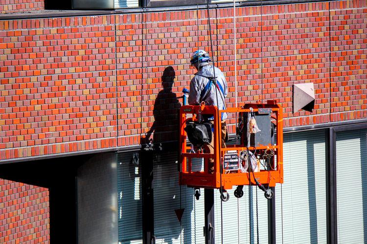 Man working on brick wall