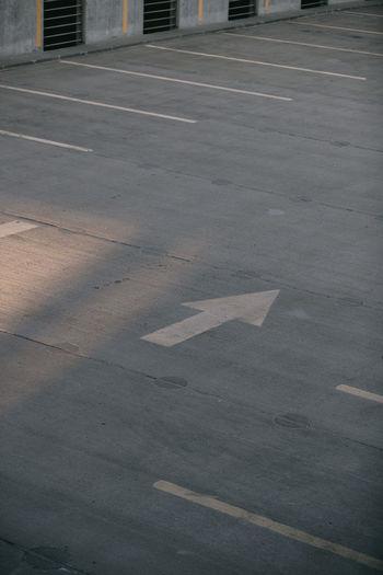 Arrow on parkade pavement.