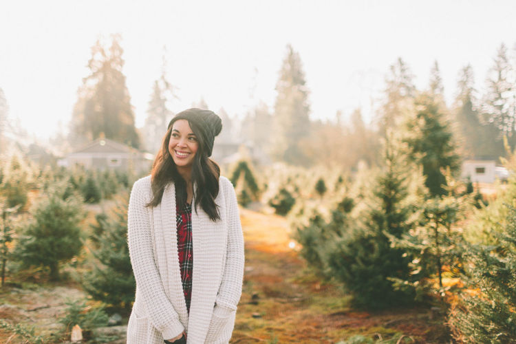A beautiful young woman at the Christmas tree farm. Holiday Moments Tree christmas tree Christmas Tree Farm Young Adult One Person Woman Smiling