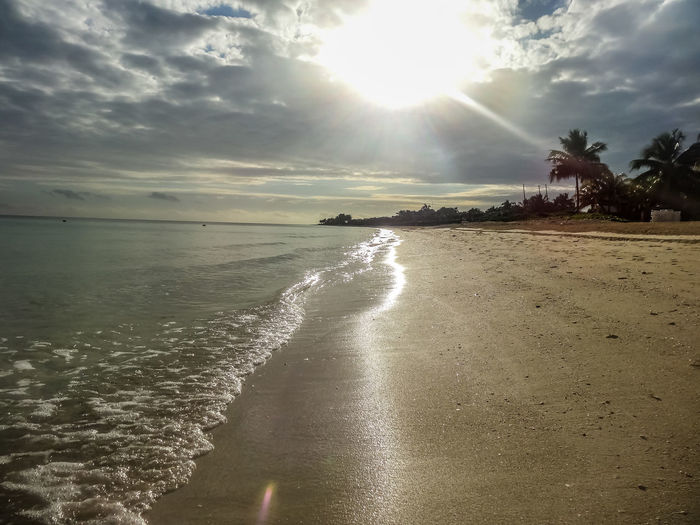 Sunrise over the beach Beach Beauty In Nature Cayo Coco Cloud - Sky Cuba Day Horizon Over Water Miles Away Nature No People Outdoors Palm Tree Sand Scenics Sea Sky Sun Sunbeam Sunlight Sunrise Tranquil Scene Tranquility Tropical Water Wave