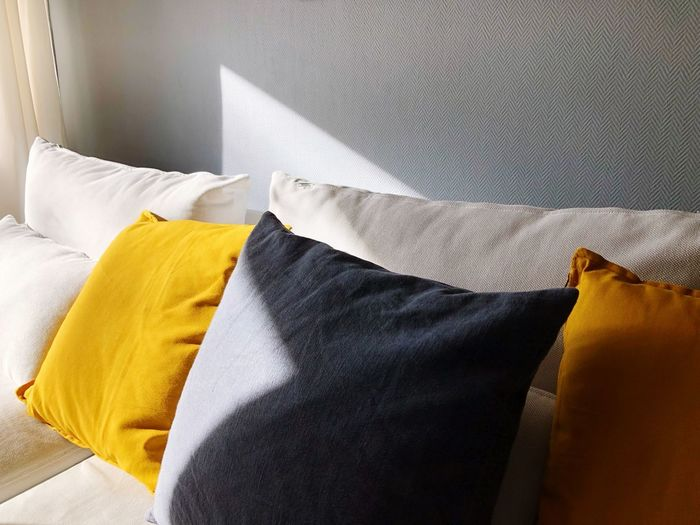 High angle view of cushions by wall