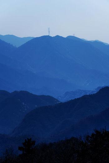 几树山花,开上山梁,几家山户,山花下藏。 mount Mountain Mountain Range No People Nature Landscape Environment Blue Outdoors Mountain Peak