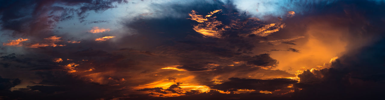 Panoramic view of nice dramatic sky at sunset time Heaven Light Panorama Panoramic Abstract Backgrounds Beauty In Nature Cloud - Sky Cloudscape Dark Dawn Dramatic Sky Dusk Environment Nature No People Ominous Orange Color Outdoors Scenics - Nature Sky Space Sunrise Sunset Sunset Sky