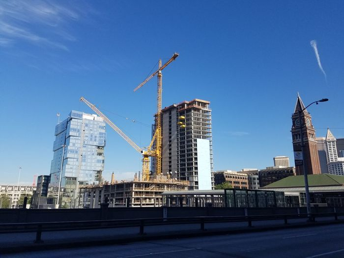 Construction Site With Buildings In Background
