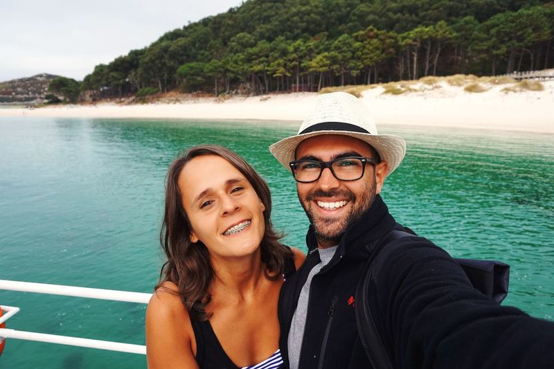 Portrait Of Happy Young Couple On Boat At Cies Islands