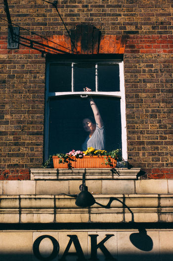 Sunday morning Sunday Morning Window Women Lady Good Morning Shoreditch Architecture Christmas Market Flowers Suny Day London Lithuanian Built Structure Building Exterior Brick Wall Indoors  Night