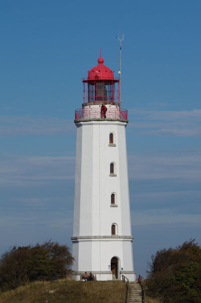 Lighthouse Hiddensee Architecture Blue Built Structure Cloud Cloud - Sky Day Lighthouse Low Angle View No People Outdoors Protection Red Hat Safety Security Sky Tranquil Scene Tranquility