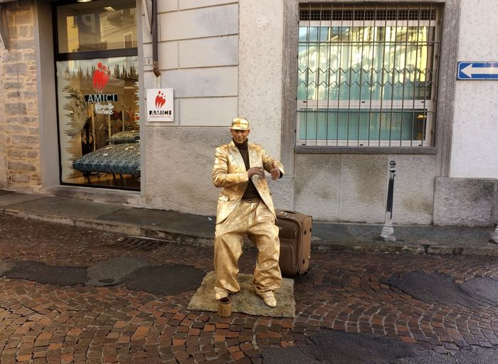 Street Artist on display for Christmas. December 24,2016-Domodossola,Piemonte,Italia Adult Adults Only Architecture Beauty Building Exterior Built Structure Christmas Cold Winter ❄⛄ Day Day, Gray Day December Dummy Headwear Hoilday Landscape Military Uniform Nature One Person Outdoors People Period Costume Snow ❄ Traditional Clothing Travel Winter