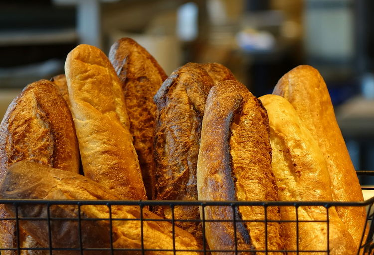 Freshly baked French bread loaves Bread Bakery Fresh Food Crust Crusty Bread Crisp Artisan Bread French Bread Golden Brown White Bread Staple Food Nutrition Loaf Of Bread Baked Focus On Foreground Carbohydrate - Food Type Still Life Freshness