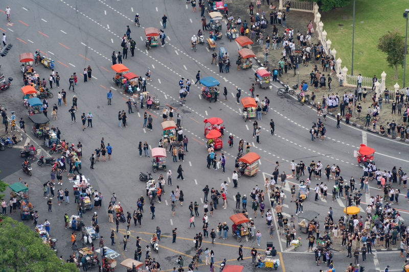 High angle view of protesters on city street during pandemic