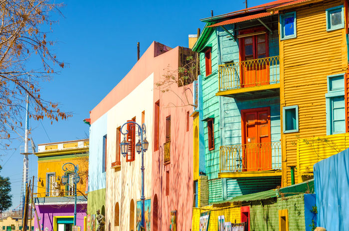 Colorful Lightbulbs in a La Boca in Buenos Aires Architecture Argentina Balconies Balcony Blue Boca Buenos Aires Caminito Colorful Corrugated Green La Boca La Boca, Buenos Aires Landmark Latin Latino Neighborhood Orange Red South America Street Tango Walls Window Yellow