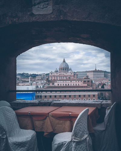 St peters basilica and buildings seen through restaurant building