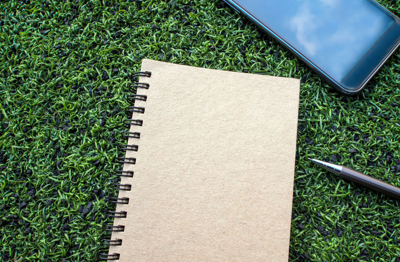 High angle view of open book on grass