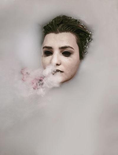 Woman exhaling smoking
