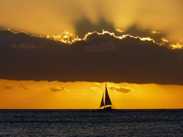 Sunset on the Indian Ocean in Grand Baie, Mauritius Island Beach Beautiful Beauty In Nature Boat Calm Cloud Grand Baie Horizon Over Water Idyllic Island Mauritius Nautical Vessel Ocean Orange Color Paradise Sailboat Sea South Sun Sunset Tranquil Scene Tranquility Tropical Water Yellow