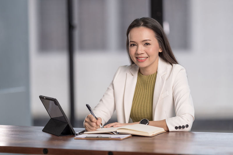 Portrait of woman working on table