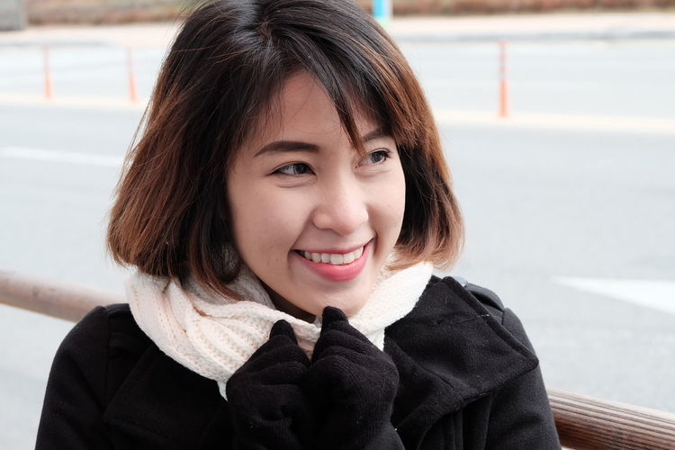 Asian woman smiling Childhood Close-up Day Focus On Foreground Happiness Looking At Camera One Person Outdoors People Portrait Real People Smiling Warm Clothing Young Adult Young Women