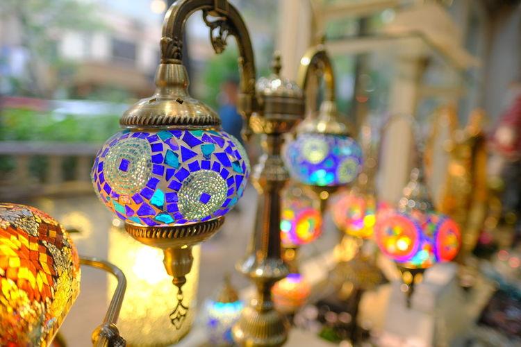 Close-up of illuminated lighting equipment at market