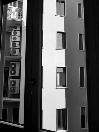 Rear window - air conditioning Architecture Building Exterior Window Built Structure Live For The Story Taking Pictures Lights And Shadows Enjoing Life From My Point Of View Atmosphere Relaxing Moments Getting Inspired Perspective Blackandwhite Photography Architecture Architecture Photography The Street Photographer - 2017 EyeEm Awards The Architect - 2017 EyeEm Awards
